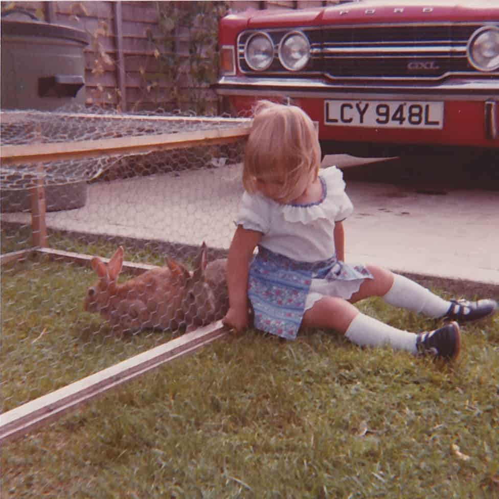 Donna, ages 2 with her rabbits Sandy and Candy